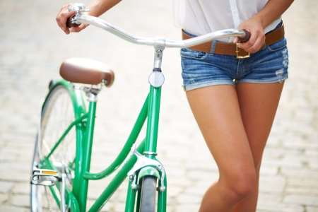 Photo for Close-up of young woman with bicycle - Royalty Free Image