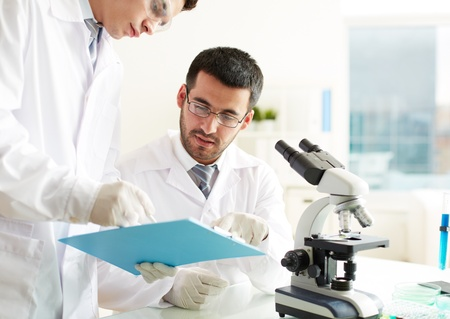 Photo for Two clinicians discussing medical document in laboratory - Royalty Free Image