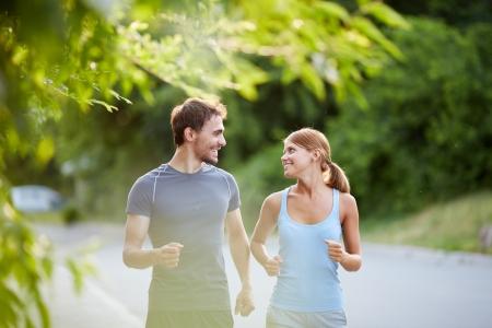 Photo pour Photo of happy couple running outdoors - image libre de droit