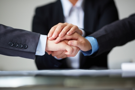 Foto de Image of business partners hands on top of each other symbolizing companionship and unity - Imagen libre de derechos