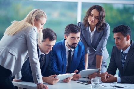 Photo pour Elegant business partners planning work at meeting - image libre de droit