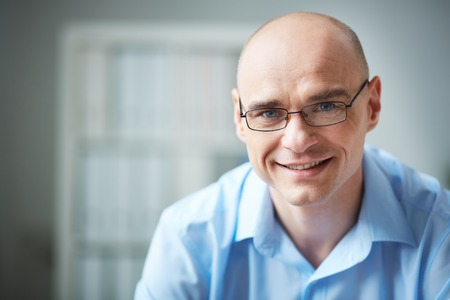 Photo for Portrait of attractive businessman in eyeglasses looking at camera - Royalty Free Image