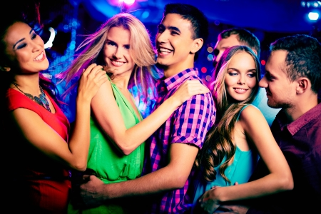 Photo for Happy young friends dancing at disco - Royalty Free Image
