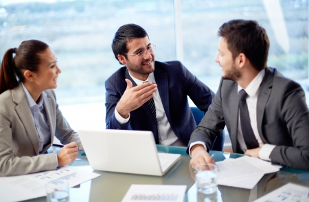 Photo for Portrait of three co-workers discussing business plan in office - Royalty Free Image