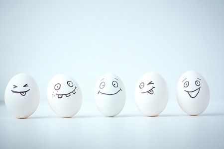 Photo for Line of Easter eggs with different facial expressions  - Royalty Free Image