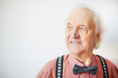 Foto de Portrait of a happy senior well-dressed man in isolation - Imagen libre de derechos