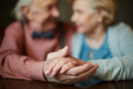 Photo for Close-up of senior female hand in that of her husband - Royalty Free Image