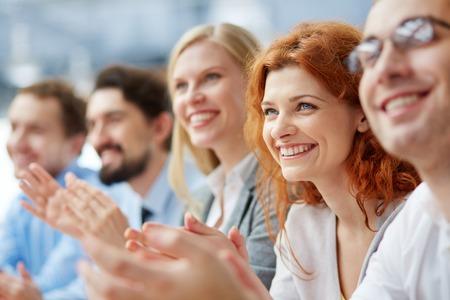 Foto de Photo of happy business people applauding at conference, focus on smiling female - Imagen libre de derechos