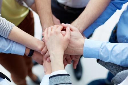 Photo pour Business partners hands on top of each other symbolizing companionship - image libre de droit