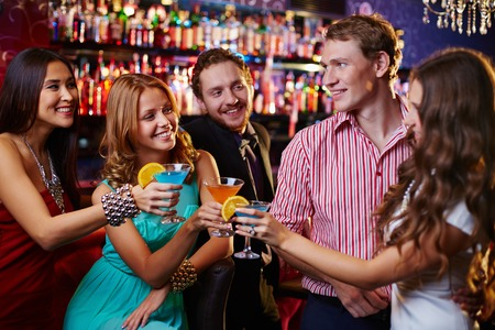 Photo for Group of friends toasting with cocktails in the bar - Royalty Free Image