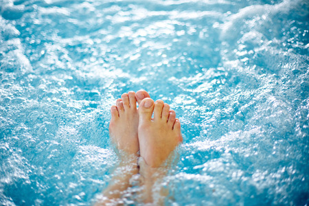 Photo for Close-up of female legs in hot tub - Royalty Free Image