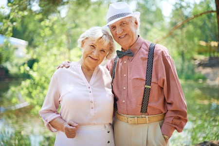 Photo for Happy seniors in smart casual enjoying summer rest - Royalty Free Image