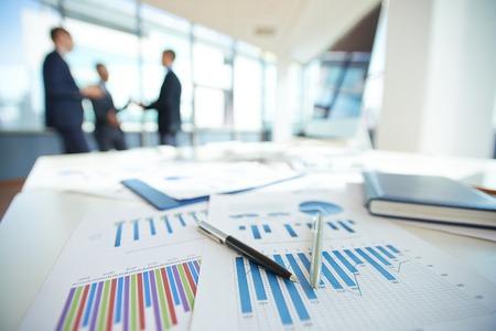 Photo pour Spreadsheets with charts on office table - image libre de droit