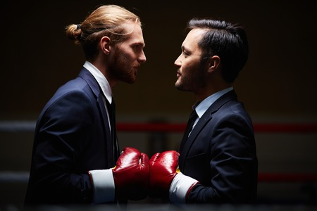Photo pour Two male business boxers looking at one another in isolation - image libre de droit
