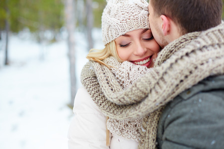 Woman embracing with her boyfriend in winter