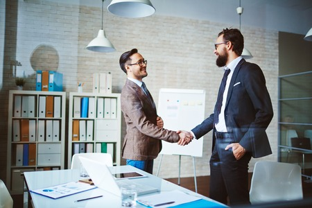 Foto de Successful businessmen handshaking after negotiation - Imagen libre de derechos
