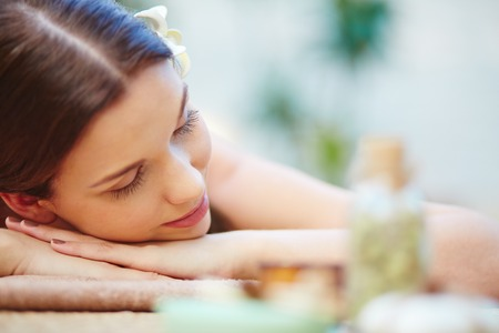 Photo for Beautiful young female relaxing in spa salon - Royalty Free Image