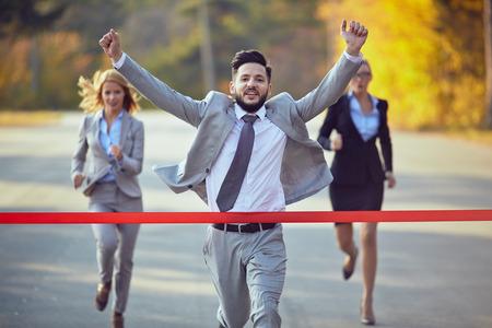 Foto de Businessman reaching finish line - Imagen libre de derechos