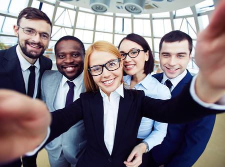 Photo pour People taking selfie at business meeting - image libre de droit