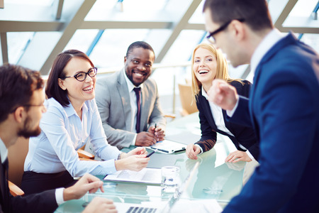 Photo for Business people laughing together at meeting - Royalty Free Image