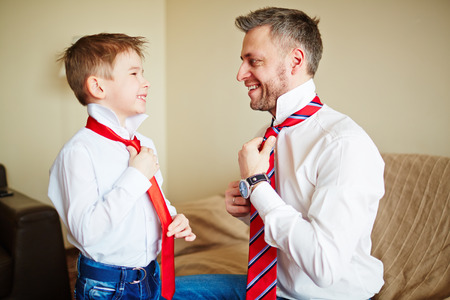 Photo for Father and son knotting ties - Royalty Free Image