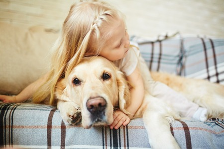 Photo for Cute child resting with dog - Royalty Free Image