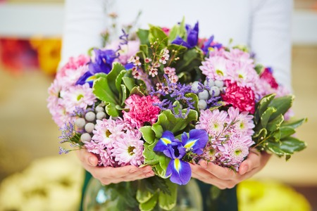 Photo for Florist hands with big floral bouquet - Royalty Free Image