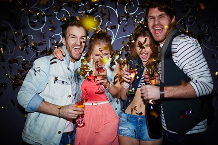 Photo for Ecstatic friends with champagne having fun at party - Royalty Free Image