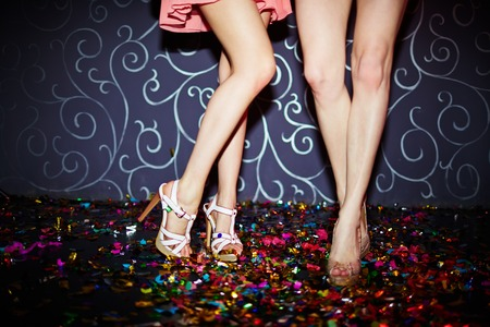Photo pour Legs of two girls dancing in night club - image libre de droit