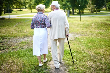 Photo for Rear view of well-dressed seniors taking a walk in summer - Royalty Free Image