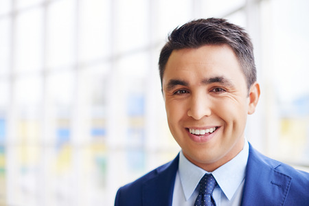 Photo for Happy businessman looking at camera with smile - Royalty Free Image