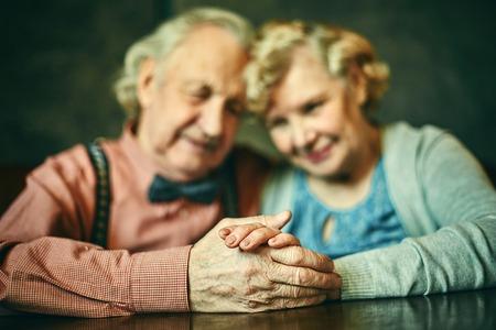 Photo pour Close-up of hands of affectionate seniors - image libre de droit