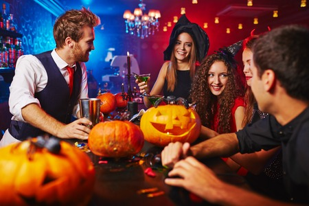 Photo for Happy witches celebrating Halloween in bar - Royalty Free Image