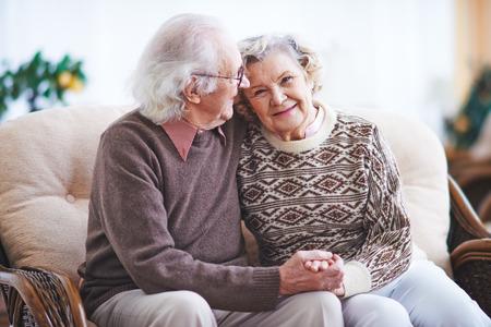 Photo pour Happy senior man and woman having rest at home - image libre de droit