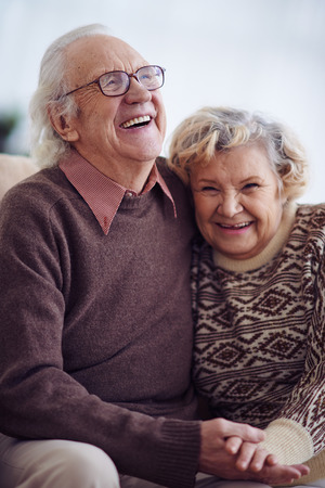 Photo for Joyful elderly man and woman in sweaters - Royalty Free Image