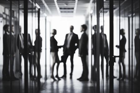 Foto de Black and white image of business people at office - Imagen libre de derechos