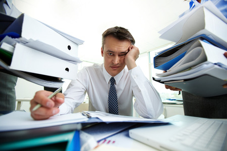 Photo pour Tired manager have so many paperwork in the office - image libre de droit