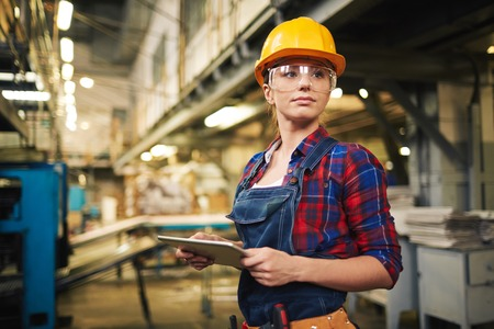 Photo for Young factory worker controlling the work - Royalty Free Image