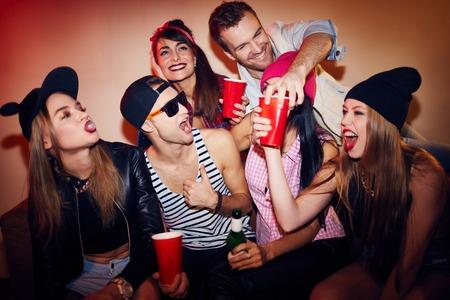 Photo pour Happy teenagers having fun during a party - image libre de droit