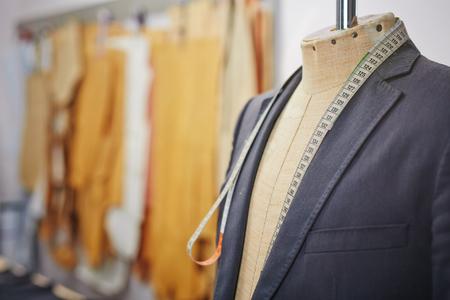 Photo pour New jacket on mannequin and measuring tape - image libre de droit