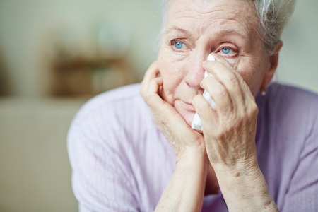 Photo for Upset senior woman wiping tears with handkerchief - Royalty Free Image