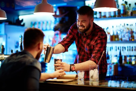 Photo for Happy barman making drink for client - Royalty Free Image