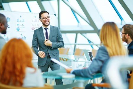 Photo pour Positive CEO holding a meeting - image libre de droit