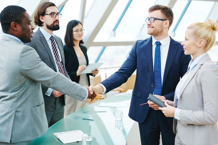 Business partners handshaking after meeting