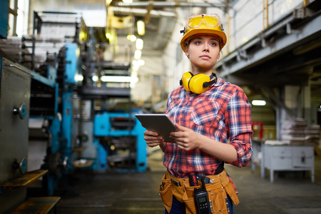 Photo for Pretty female student doing practical work at factory - Royalty Free Image