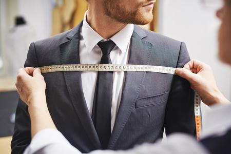 Foto de Tailor measuring front of businessman jacket - Imagen libre de derechos