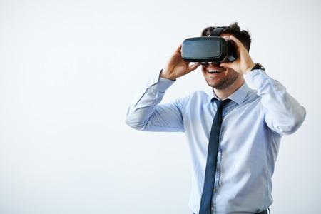 Photo pour Portrait of excited businessman in vr goggles - image libre de droit