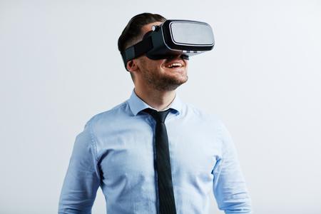 Photo pour Young businessman trying vr goggles - image libre de droit