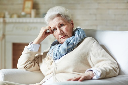 Photo pour Serious pensioner looking at camera - image libre de droit