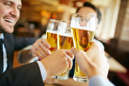 Photo for Businessmen drinking beer after successful deal - Royalty Free Image